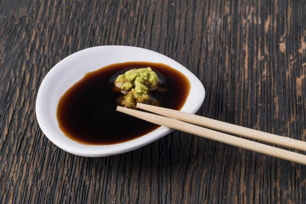 Bowl with soy sauce and wasabi